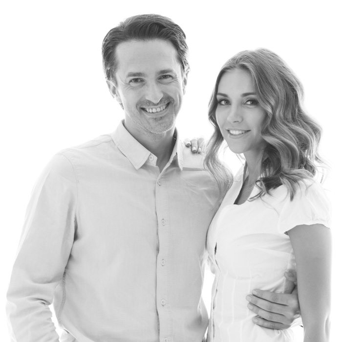 happy-couple-smiling-on-white-background