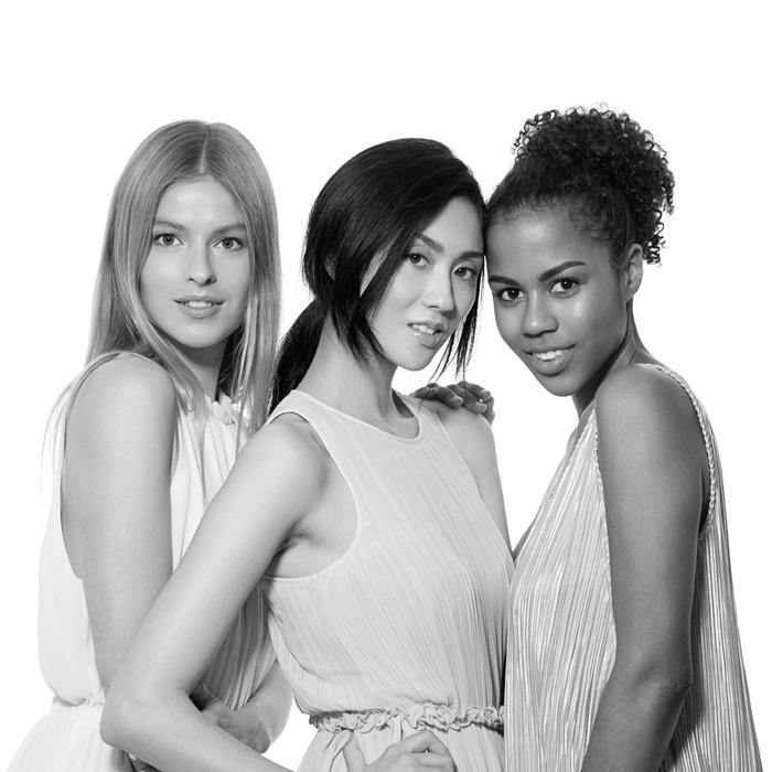 three-multinational-women-posing-together