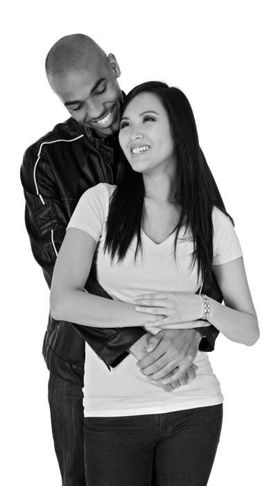young-diverse-couple-embracing-and-smiling